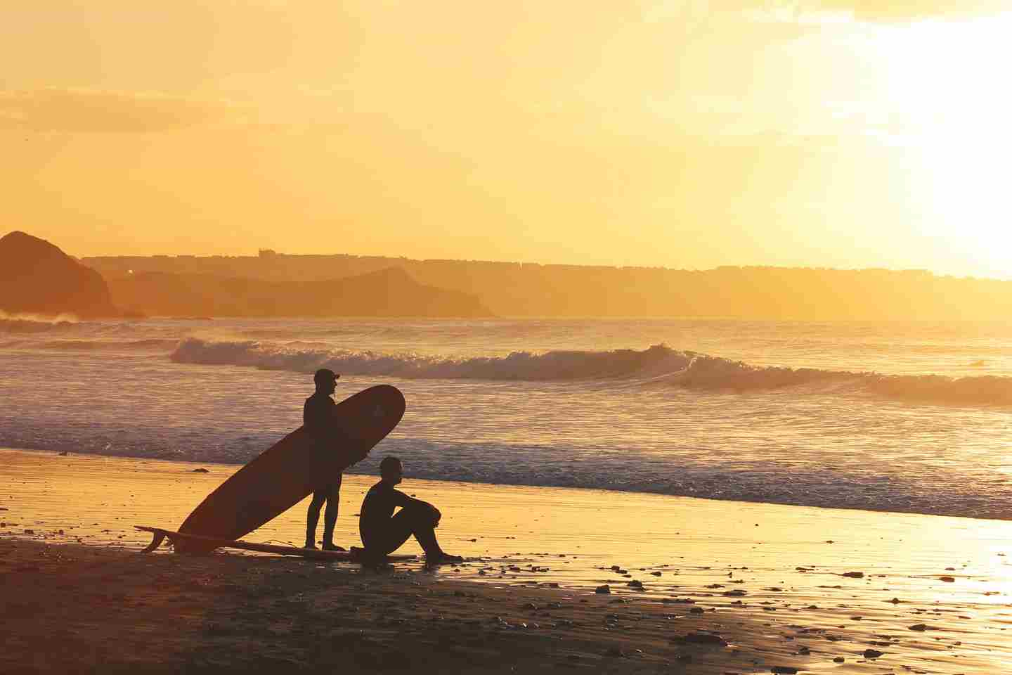 2 surfers watching the sunset.jpg