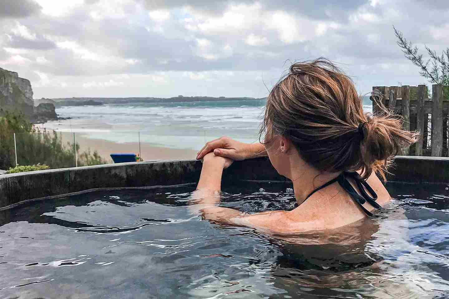 Woman-in-the-hot-tub-overlooking-the-beach.jpg