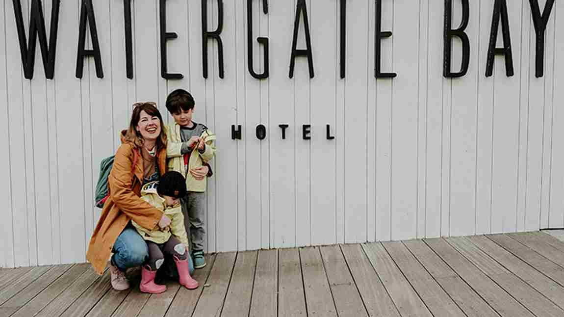 Young-family-outside-Watergate-Bay-Hotel-sign.jpg