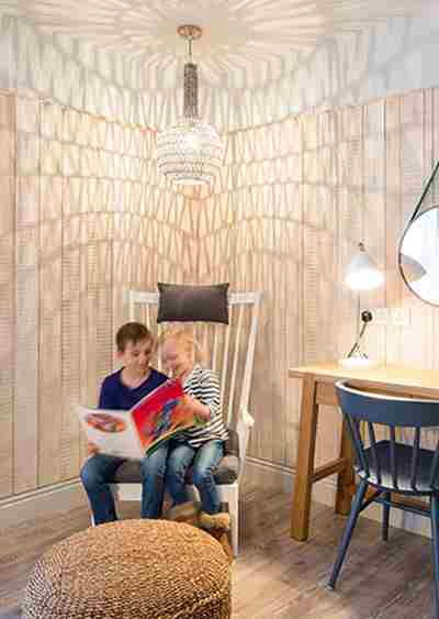 Children-reading-a-book-in-a-family-suite.jpg