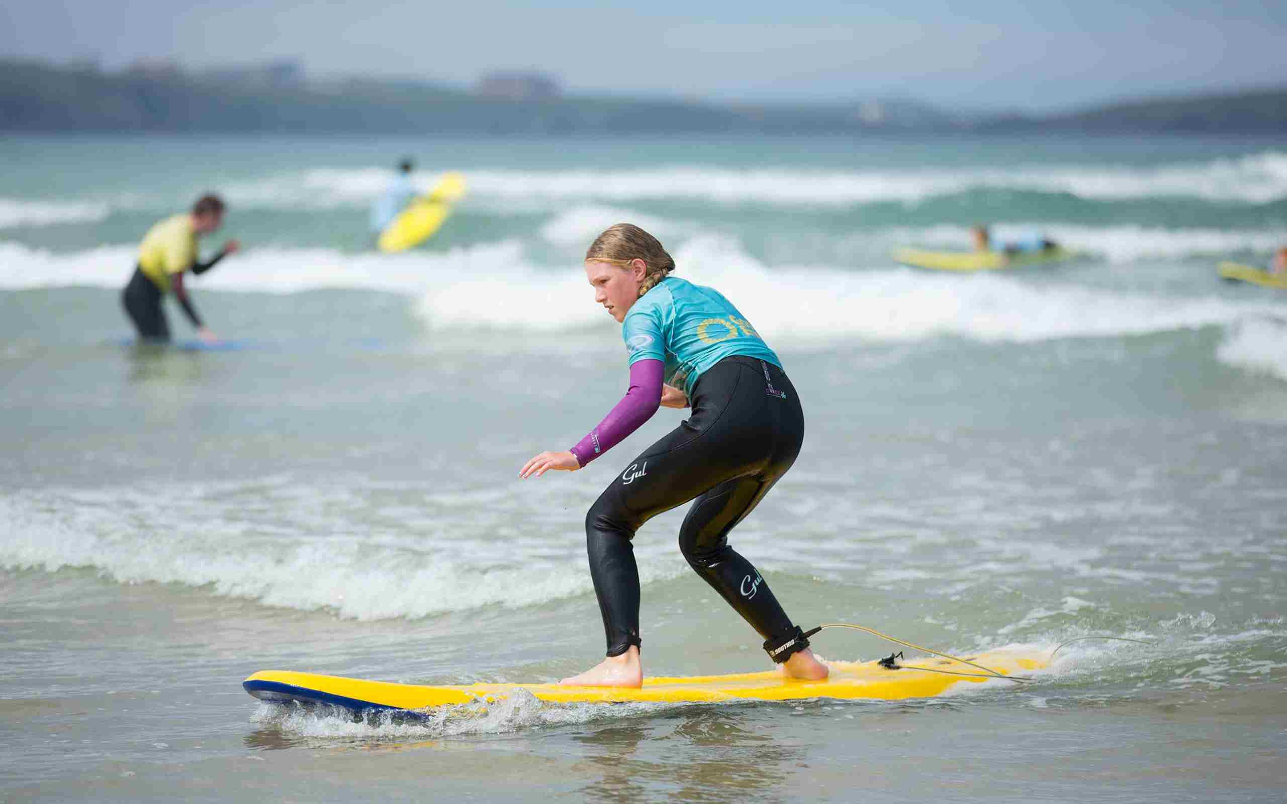 Girl-learning-to-surf-with-the-Extreme-Academy.jpg