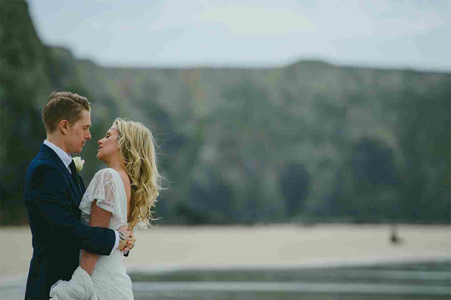 Bride-and-groom-on-Watergate-Bay-beach.jpg