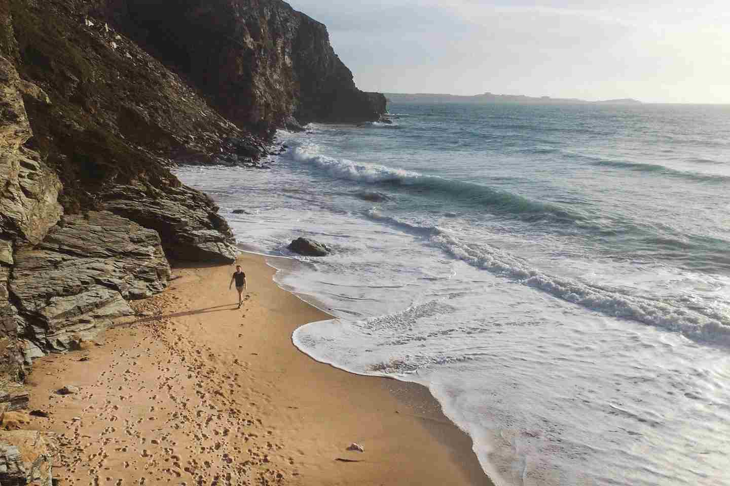 Aerial View Of Man Walking Along Watergate Bay