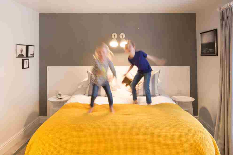 Kids Jumping On The Bed